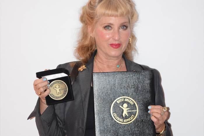 Kimmy Robertson was named a recipient of the 2018 Motif Award Global Humanitarian Medal of Honor